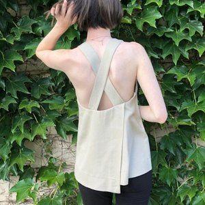 Babaton cross back asymmetrical blouse